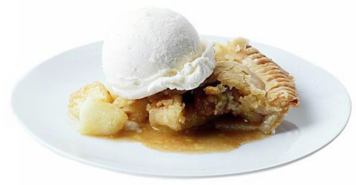 Runny slice of apple pie topped with a large scoop of vanilla ice cream